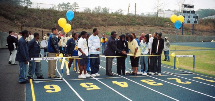 Rickards cutting the ribbon